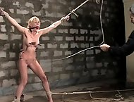 Sexy young blonde gets tied up, sprayed, dunked and fucked