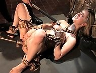 Beautiful slave girl takes on two cocks