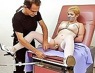 Master Savage hoists his slave into the stirrups for a specialized exam