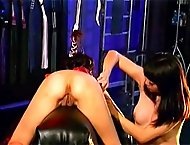 FemDom action with an Asian slave having her pussy and ass abused by her dominant mistress