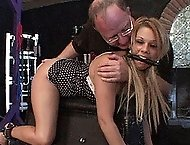 Sexy blonde Jenna has a fun time sucking cock in the dungeon