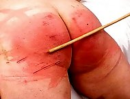 Fat Ass slave Ariel gets her wide bottom caned and flogged until its pulsating and red
