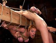 2 girl's, massive tits, bound, 1 suspended, 1 neck tied down & arched.Both made to brutaly cum!